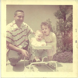 My dad, Sam Ross, me in the baby chair, my sister, Gina.